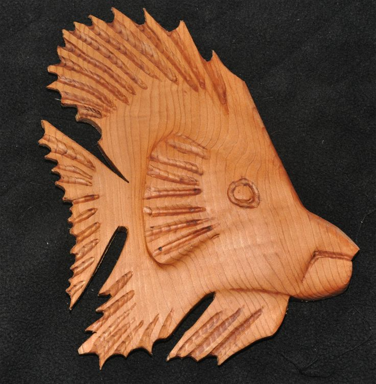 """Red cedar carving for hanging on a wall.  It is about 8"""""""