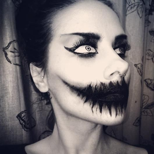 Ghastly #Halloween Makeup Ideas. Cat eye with false eyelashes will add to the ghastly look you are going for this Halloween. Add #FalseLashes to your Halloween eye makeup this year!