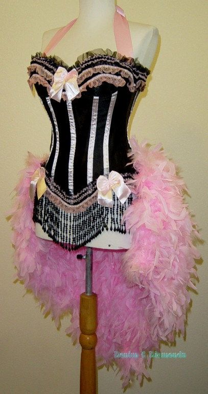 Elegant burlesque style costume made with a black bodice base accented with lots of pink ribbon and lace. Bodice is boned with hook and eye