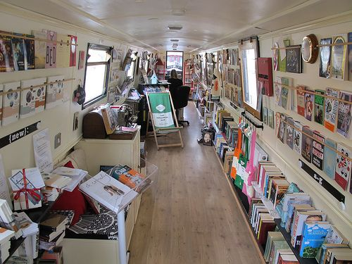 The Book Barge a narrow boat that travels around the UK, transporting its book-trade from city to city, via old canals and waterways.