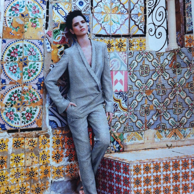Tunisian model Hanaa Ben Abdesslem is one of the few representatives of the Arab world  on the catwalks of New York, Paris and Milan. Here she poses against a wall of beautiful Tunisian tiles in the medina of Tunis. The pant suit is by Stella McCartney. Hanna  was born in Nabeul, Tunisia, in 1990. She studied Civil Engineering. Her father is a Civil Engineer