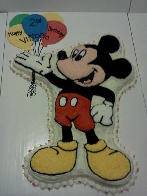 Mickey Mouse Cake: I used the Full Body Mickey Mouse Cake Pan by Wilton. This cake was a coconut cake with caramel filling.                     Related Cakes