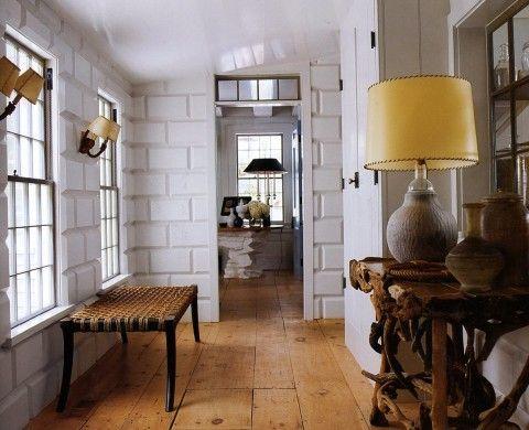 Wide plank floors, walls, sconces  Steven Gambrel's Sag Harbor home