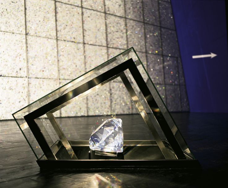 The Centenary, the world's largest ever manufactured crystal, is displayed at the centre of the collection of art being exhibited in the Entrance Hall of Swarovski Crystal Worlds in Wattens, Tyrol. The stone, which weighs a massive 300,000 carats, has a diameter of 40 cm and features 100 hand-polished facets to symbolize the century of Swarovski history and tradition. In contrast, the smallest precision-cut crystal ever manufactured by Swarovski is displayed alongside the Centenary.