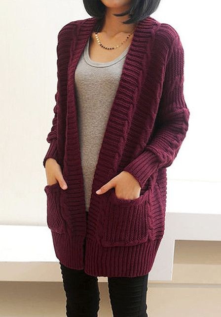 A chunky sweater cardigan featuring a braided pattern and split back. Open-front. On-seam pockets.