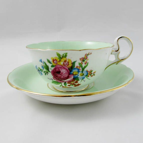Pretty green tea cup and saucer, with a flower bouquet on the outside of the cup and center of the saucer. Gold trimming on cup and saucer edges. Made by Royal Grafton. Excellent condition (see photos). Markings read: Royal Grafton Bone China Made in England Please bear in mind that