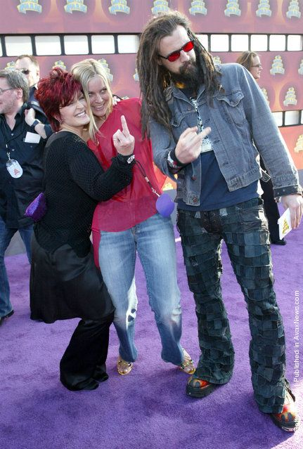 Sharon Osbourne and Rob Zombie with Robs wife in the middle looking on