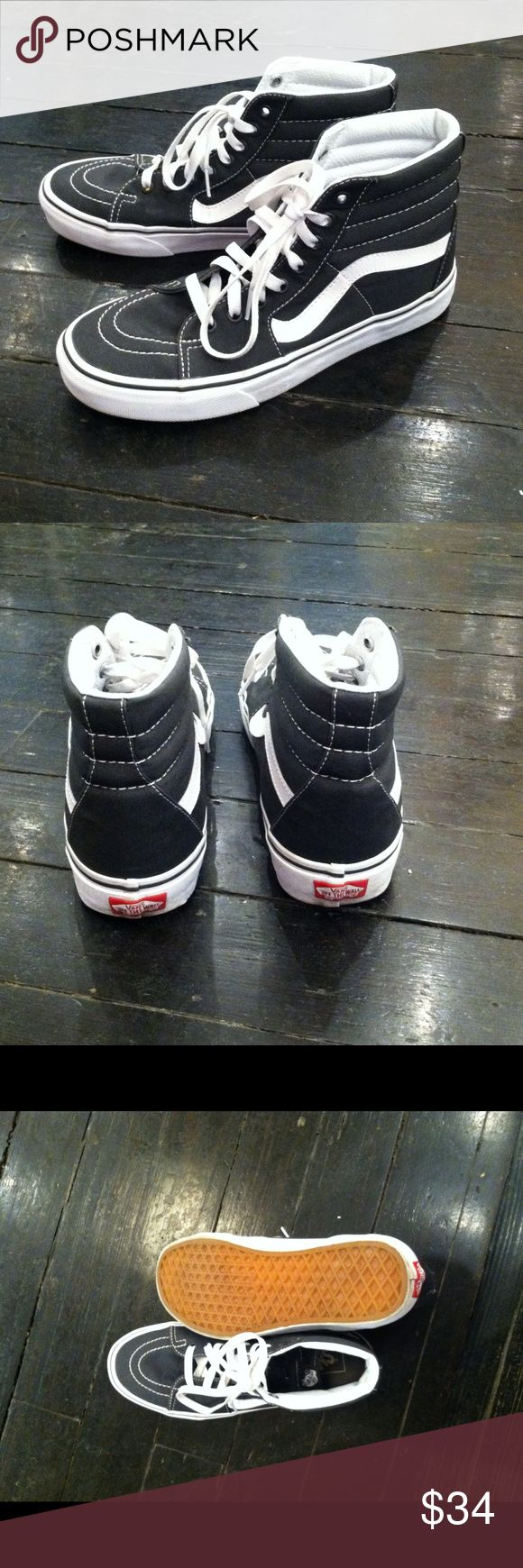 Vans Hi Top Sneakers Worn only once. In perfect condition! The were a gift and were the wrong size. Very comfortable though. Vans Shoes Sneakers