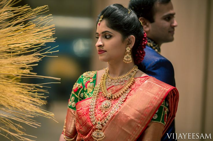 South Indian bride. Temple jewelry. Jhumkis. Red silk kanchipuram sari.Braid with fresh jasmine flowers. Tamil bride. Telugu bride. Kannada bride. Hindu bride. Malayalee bride.Kerala bride.South Indian wedding