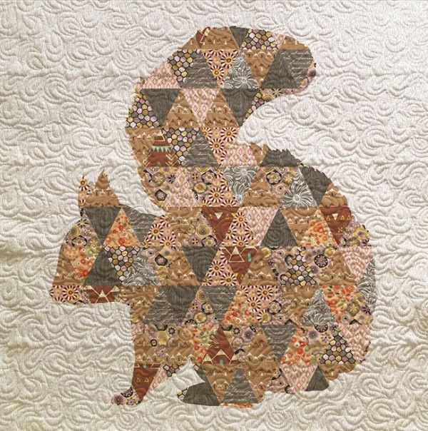 Is there a squirrel lover in your family - then this quilt may be perfect for you. This little guy may be shy but he is sure to steal the spotlight in any room. Customize the quilt with any fabrics or