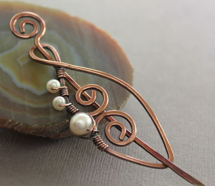Swirly leaf shawl pin, scarf pin in copper with wrapped white pearls. $28.00, via Etsy.