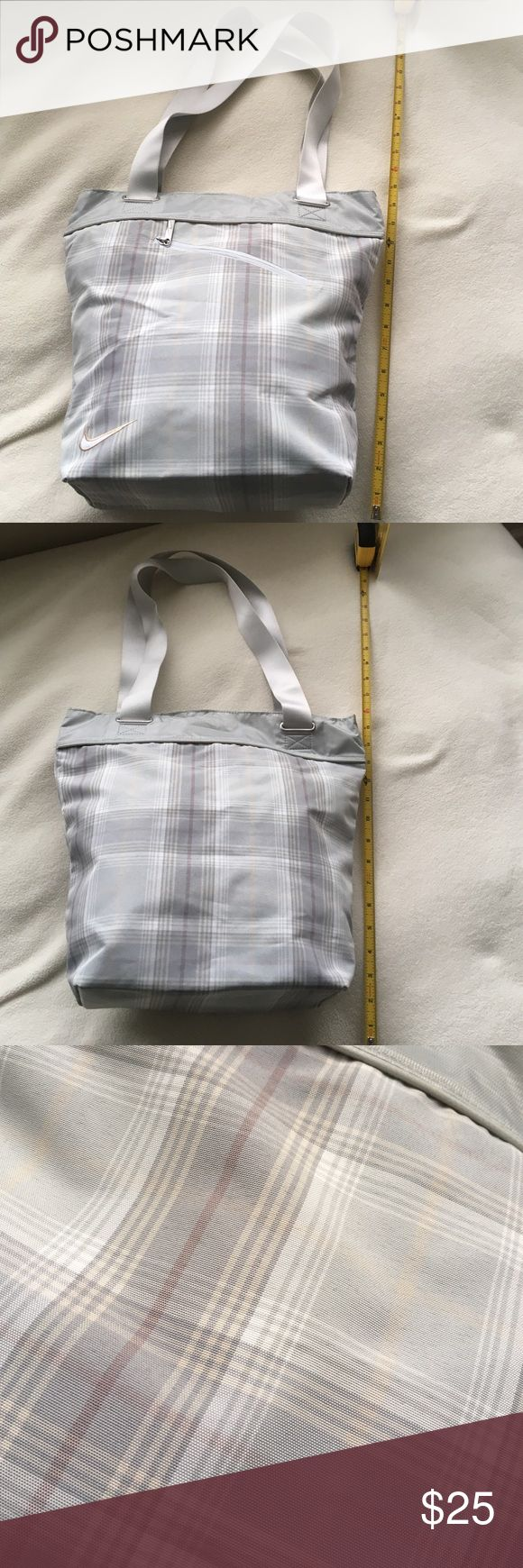 "Nike tote bag Nike tote bag. Perfect for those days when going from work, to the gym, to the store transition bag! Fits comfortably over your shoulder and is about 14"" deep and 11"" wide. Has been used a few times, but still in great condition. Minimal signs of wear shown in third picture. It is a grey and white plaid color patten. Nike Bags Totes"