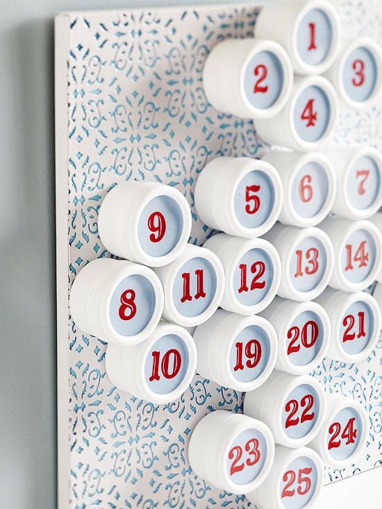 A cluster of small lidded storage containers is transformed into a countdown holiday calendar.