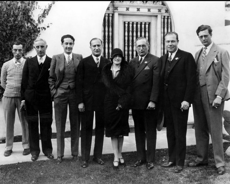 Buster Keaton, Harry Rapf, Irving Thalberg, Mrs. Keaton , Louis B. Mayer, Eddie Mannix, Hunt Stromberg, in the early 1930s.