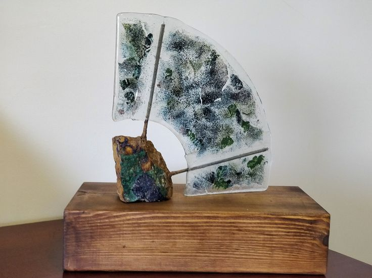 An Ode to Minerals made of rock, fused glass and metal on wooden base by Beth Erez 35x36x18 cm