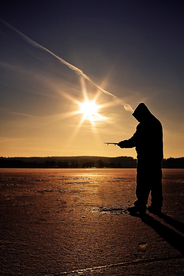 Ice Fishing in winter scene