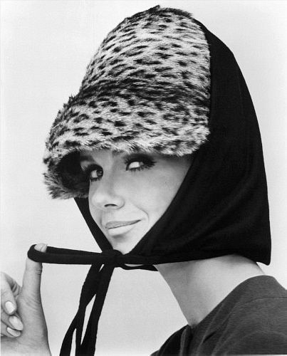 Nicole de la Marge in an Otto Lucas jersey scarf over an ocelot hat, photo John French. London, UK, 1964