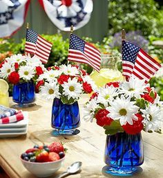 Fill vases with blue food coloring. These are Fourth of July decorations, but I think it would be just as cute for the center pieces at my wedding!