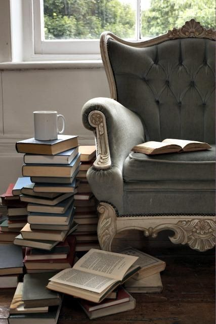 ♥ Darn, this looks like several spots I have books stacked and stacked and stacked and sliding around a comfy chair.... it's an epidemic!