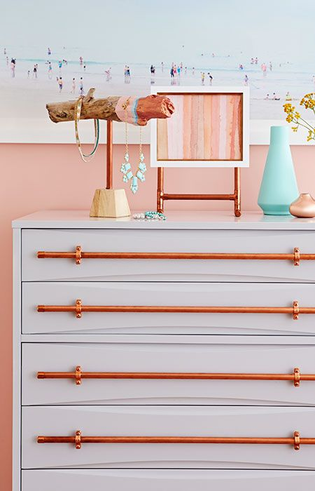 Transform a piece of outdated furniture with rugged drawer pulls made from copper pipe and fittings.