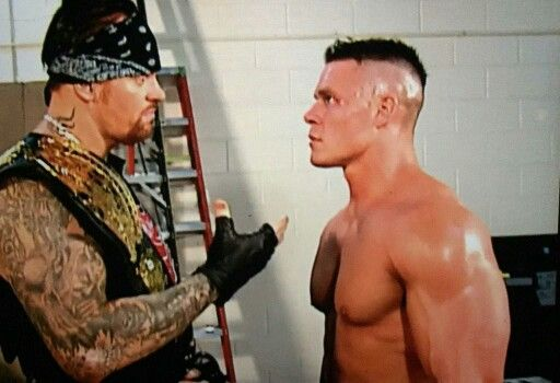 when John Cena debut in 2002 in WWE his first match was against Kurt Angle afterward the match was over John was backstage and Undertaker walk up to him and start talking to him