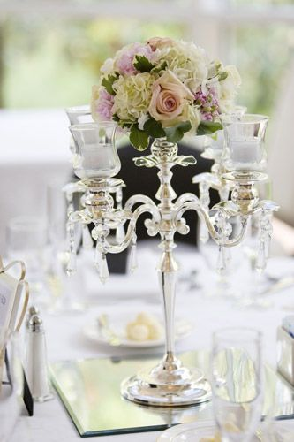 Mixed small floral pomendar with candleabra base and candles covered (no open flame)