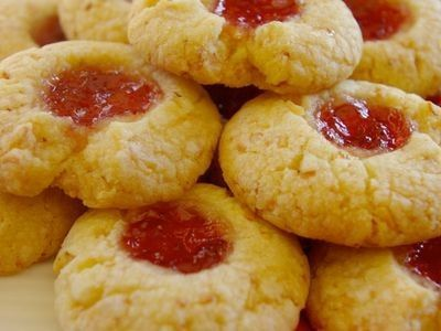 Melt in your mouth shortbread, with the nutty crunch of coconut and sweet tartness of jam. As pretty as they are delicious.