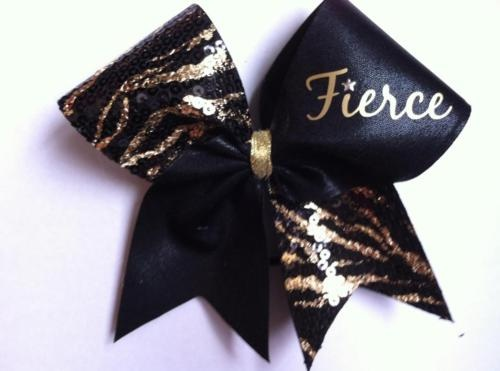 Lettering and zebra in red and this would be our cheer bow!! OK Heat Fierce!!(: