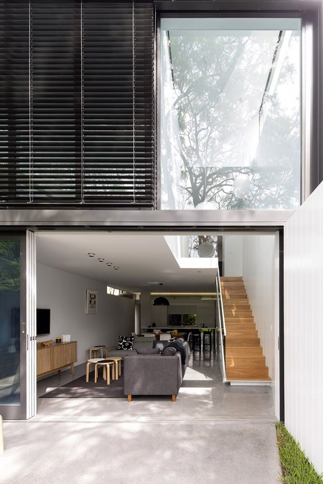Originally existing as a small bungalow, the Cosgriff House has been converted by Australian architect Christopher Polly into a two-storey house with extra rooms behind and underneath. The changes have more than doubled the usable floor area of the family residence, located in the Sydney suburb of Annandale, offering a new batheroom, bedroom, and study room, while the the extra storey below features a large open-plan living and dining room. To keep the building light and airy, Polly also…