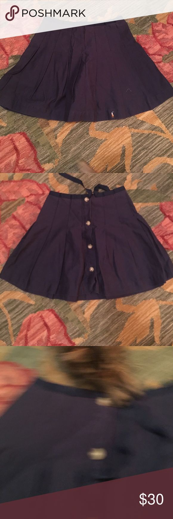 Ralph Lauren navy pleated skirt Cute schoolgirl-esque pleated skirt with buttons and a ribbon tie. Gently worn, no damage, might work for a school uniform or just everyday wear. Says size 14 but looks much smaller, maybe an 8. Ralph Lauren Skirts Mini