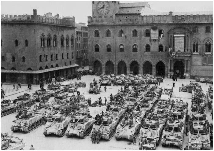 This shot of the 752nd Tank Battalion in Bologna Italy, April 1945 has one in the front row. 3rd from right.