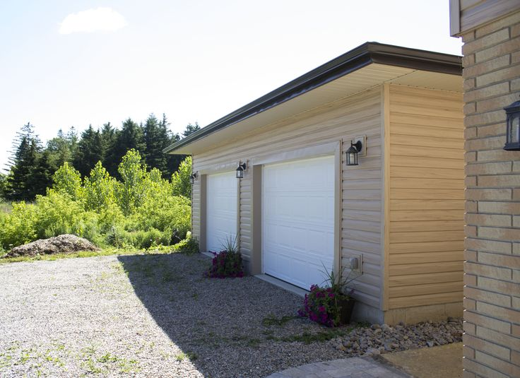 Detached garage added to this home - matching siding added to both existing home and new garage.