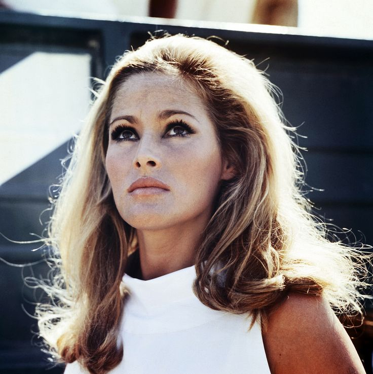Ursula Andress.   60s  fashion -- sleeveless mock-turtle is so stylish!