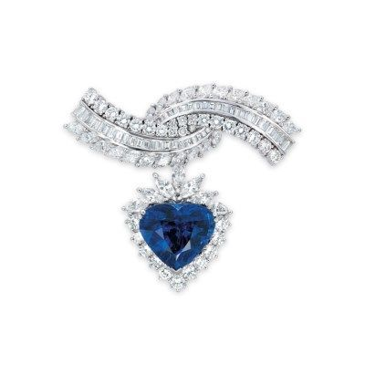 A SAPPHIRE AND DIAMOND BROOCH. The detachable pendant set to the centre with a heart-shaped sapphire, within a brilliant and marquise-cut diamond surround, suspended from the overlapping arched brooch set with vari-cut diamonds, mounted in white gold, 5.6 cm long. #sapphirejewelry