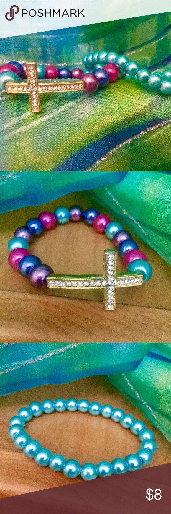 New Multi Color Bead Cross Bracelet set New Multi Color Bead Cross Bracelet set.  Bracelet has a cross with clear stones and pink, blue, purplish and teal beads. Second bracelet is all teal beads. Bracelets are stretchable Jewelry Bracelets
