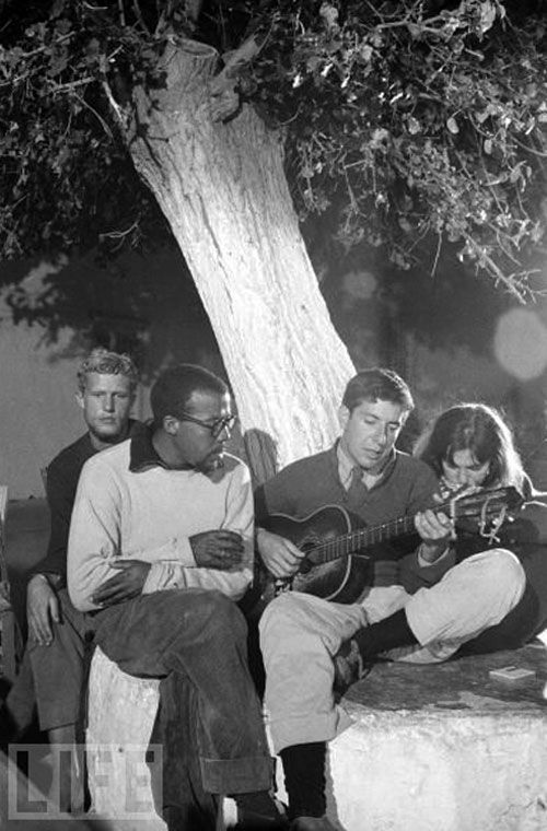 Leonard Cohen playing guitar at Douskos taverna, Hydra island, Greece