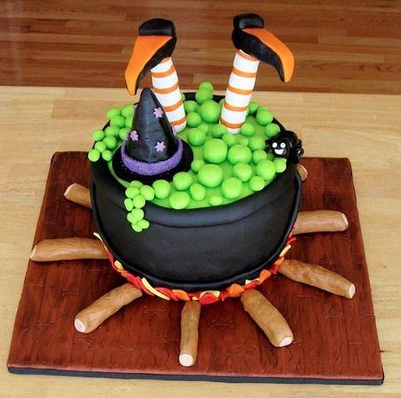 I love the cute simplicity. Makes me want to make a large cauldron cake.  Cake Wrecks - Home - Sunday Sweets: HalloweenTreats