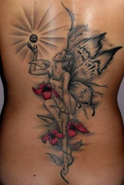 Amazing Extreme Crazy Angel With Lovely Flowers Tattoo Design Make On ...