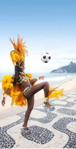 Samba dancer playing soccer on the beach, Rio de Janeiro