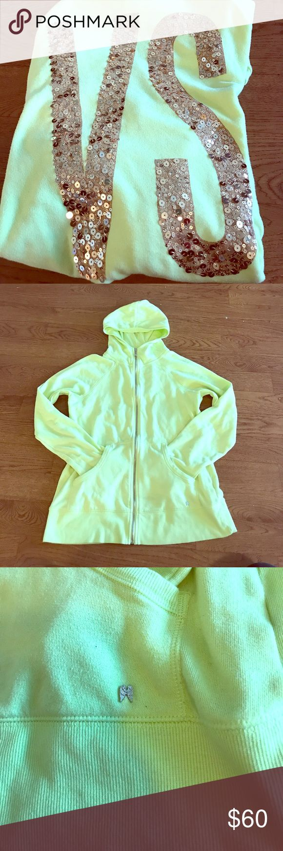 "Victoria's Secret Neon Green Zip Up Hoodie Lg Beautiful neon green, super comfy, oversized zip up hoodie. Back of the Hoodie has HUGE ""VS"" initials in gold sequins... all intact.... Hoodie does have some small, very light spots (not stains... I have not washed/dried or treated these so there is a good chance they can come out) pockets in the front. Hoodies measures from shoulder to bottom 25inches... width 19 inches... these measurements were taken on a flat surface, they could be off a half…"