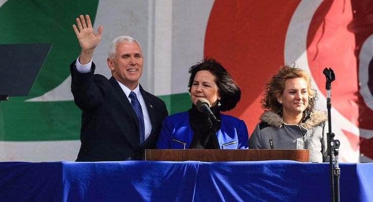 Pence waves to the March for Life crowd with his wife, Karen Pence, and his daughter, Charlotte Pence.