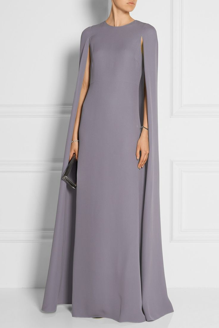 VALENTINO Silk-cady cape gown $6,990|EDITORS' NOTES & DETAILS Capes feel at once sophisticated and elegant, which is why we love Valentino's flowing silk-cady gown. This floor-sweeping style is expertly draped so it won't envelop your figure, instead delicately framing your shoulders. We love the dusty-lilac hue with silver accessories.