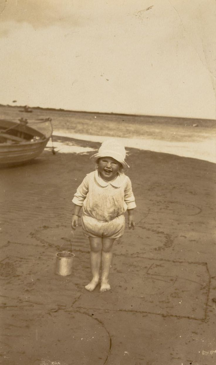 Photograph of Nancy Fletcher, aged approximately 2 1/2 at either Red Bluff or Ricketts Point in her bathing costume, about 1926 or 1927. Being at the beach was a big part of Nancy's childhood. Nancy's Dad Stan would meet her and her mother Ethel at the beach. He would come straight from Sandringham Station and they would walk down from their house in Rose Street, and they would all have a picnic ...