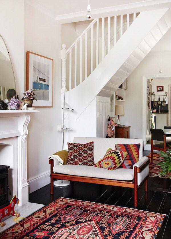 plain sofa cool rug and pillows