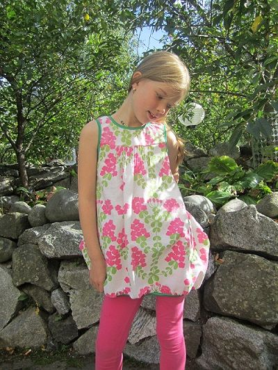 The girl's dress from recycled materials.