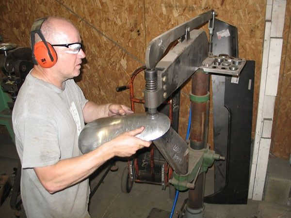 Planishing Hammer by James Bowler -- Homemade planishing hammer constructed from a surplus drill press column and a pneumatic hammer. http://www.homemadetools.net/homemade-planishing-hammer-7