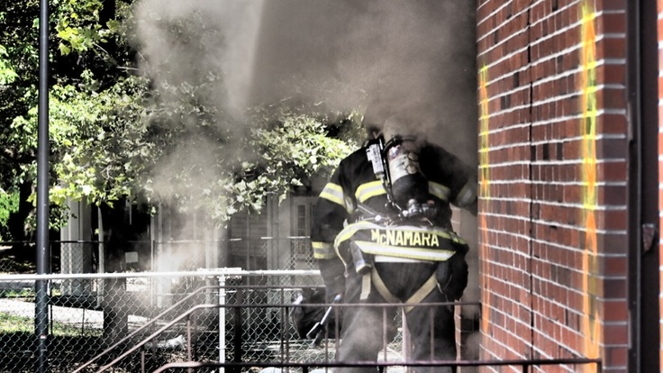Firefighter ready to enter one of the premises during a fire test on Governor's Island. www.ul.com