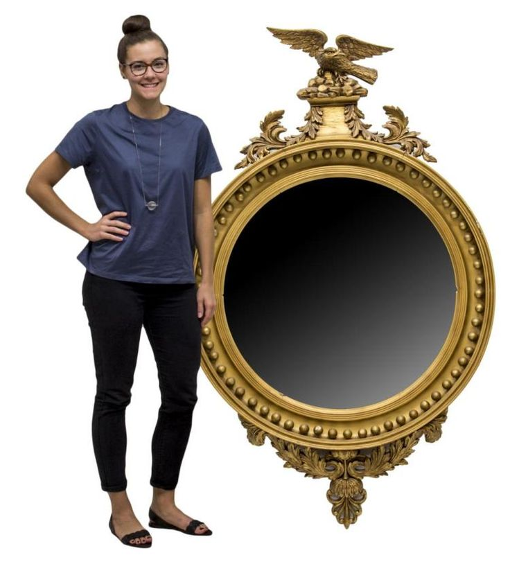 """Monumental American Federal style giltwood and gesso convex wall mirror, 19th c., surmounted by an eagle on rocky plinth, terminating in scrolling acanthus leaves, roundel trim around the convex mirror plate, fracture and loss at center of frame, spotting to mirror silver, 71""""h, 44.5""""w, 5""""d **Provenance: From the historic Nelson-Crier house Round Rock, Texas** Start Price: $800.00"""