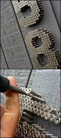 An unusual idea for house numbers.This is an industrial idea that uses screws driven into your home to write out your house numbers.