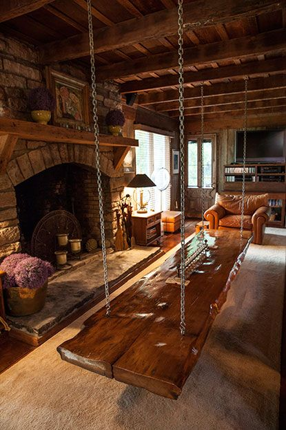 Photo Credit: Hollis Bennett. Inside Debbie Church's home, Dixon created the hanging coffee table from a solid piece of wood.